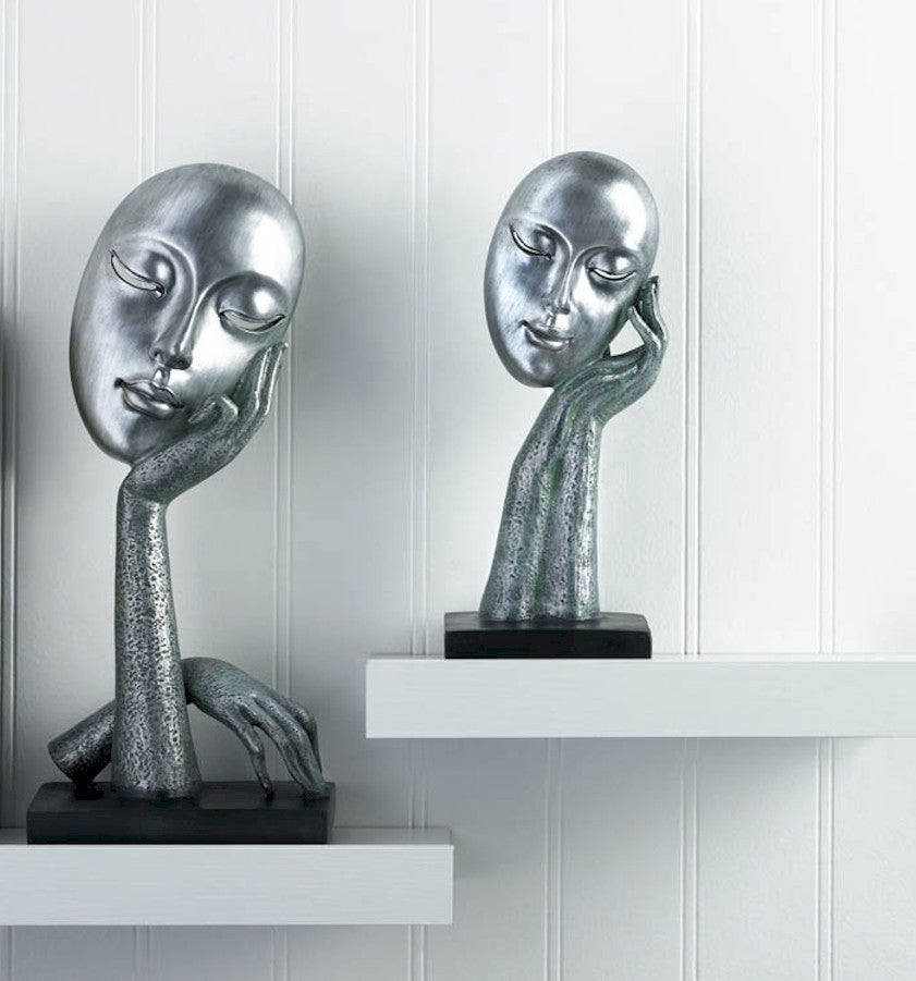 Abstract Faces Statues