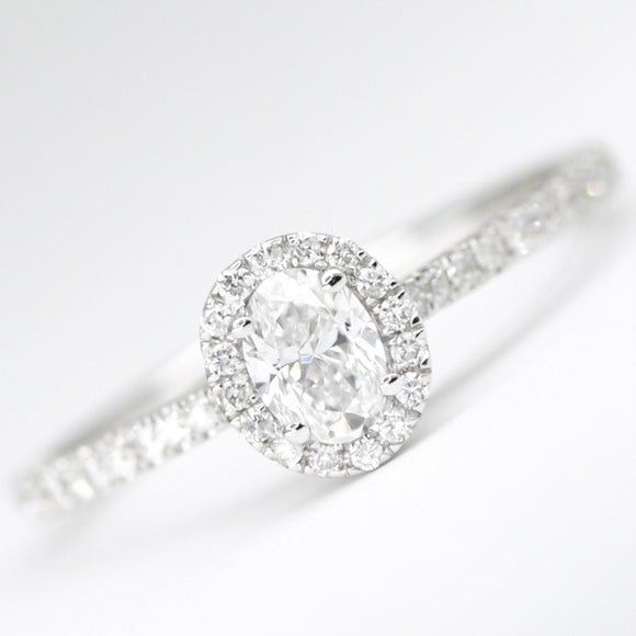 18ct White Gold Oval Diamond .49pts Halo Ring
