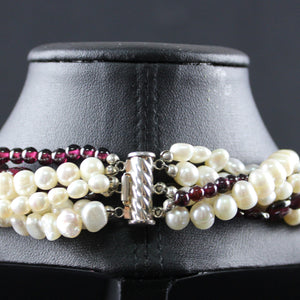 Susan M - Multi strand pearl and garnet necklace