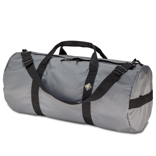 Studio photo the Steel Grey SD1430DLX Standard Duffle by Northstar Bags. 75 liter duffel with diamond ripstop fabric, thick webbing straps, and a large format metal zipper. Guaranteed for life.