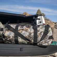 Load image into Gallery viewer, Lifestyle photo of King's Camo Desert Shadow print SD1224DLX Standard Duffle by Northstar Bags. 44 liter duffel with diamond ripstop fabric, thick webbing straps, and a large format metal zipper. Guaranteed for life.