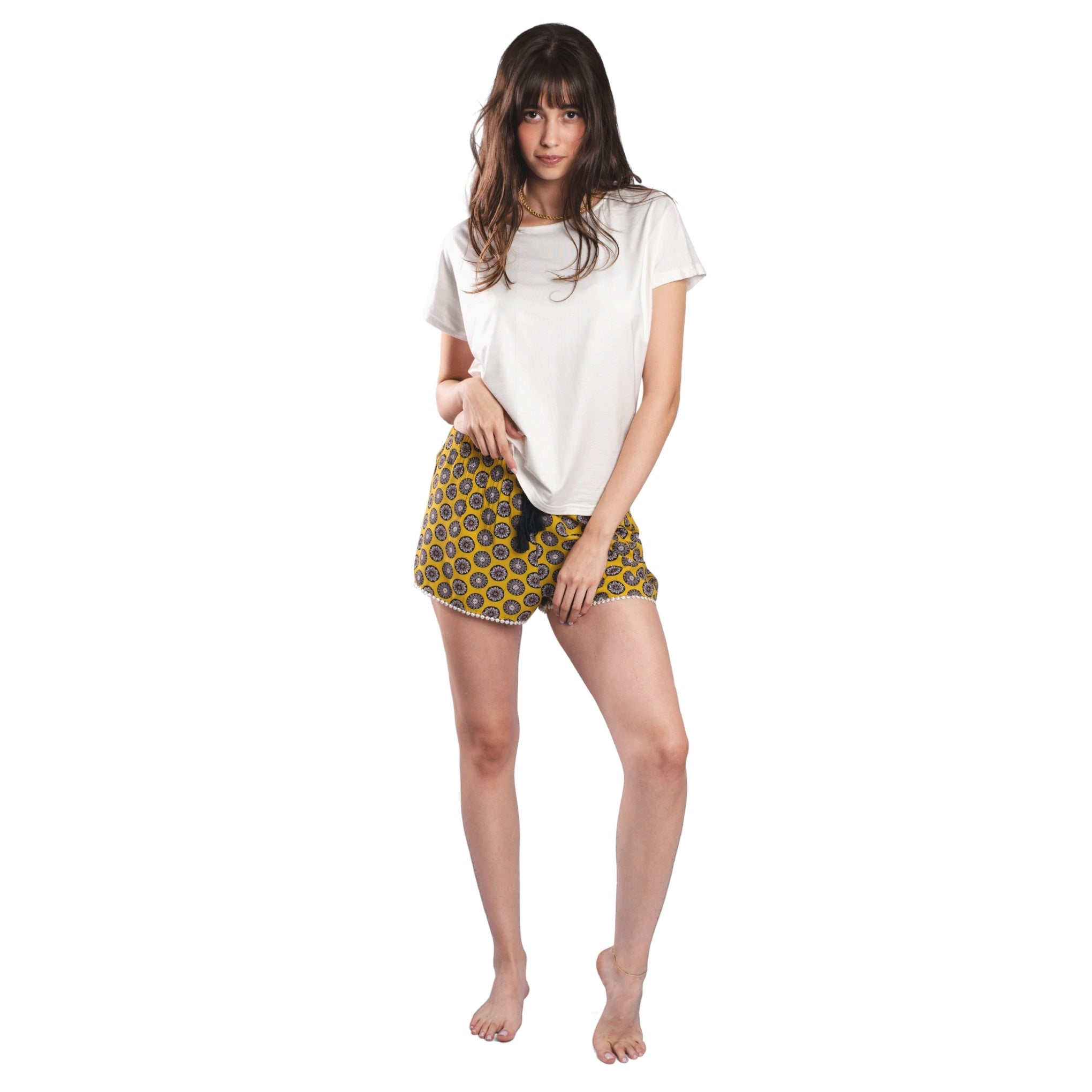White T-shirt On Patterned Shorts