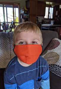 6 year old boy wearing fabric face mask for 3-6 year olds