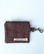 Load image into Gallery viewer, Back of wallet shows an open zipper at top, lobster claw clip at right side. Cotton label on bottom right of wallet reads www.blissjoybull.com