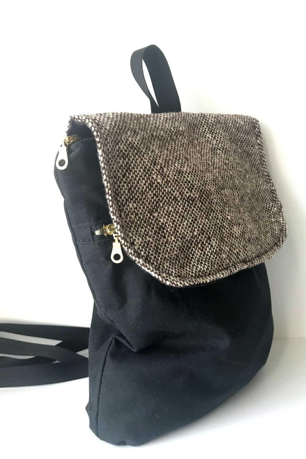 small backpack purse in black waxed canvas with brown and white tweed flat and gold brass zippers