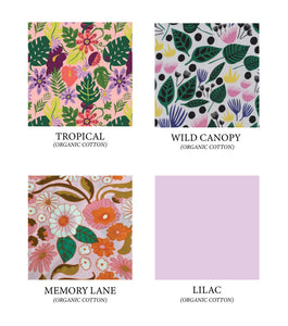 Hand warmer color options: Tropical (floral in purple, pink, green and neon green on pink background), Wild Canopy (floral in pink, yellow, blue and green on white background), Memory Lane (retro 70's print in pink, orange, green, and brown), and Lilac (light purple).