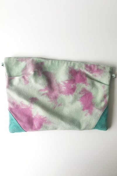 mint green with magenta dyed splotches with teal leather corners zippered pouch against white background