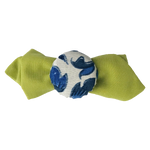 Load image into Gallery viewer, Hair pin in the shape of a mini lime green bow tie with blue and white flower print fabric covered bottle cap