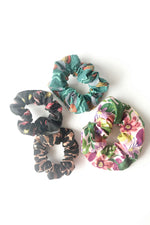 Load image into Gallery viewer, four hair scrunchies in various prints laid form a circle