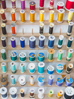 Load image into Gallery viewer, colorful sewing threads on wall