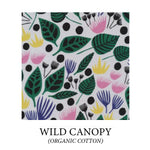 Load image into Gallery viewer, (wild canopy) large geometric green and black leaves and pink, yellow, and purple flowers on white background - organic cotton