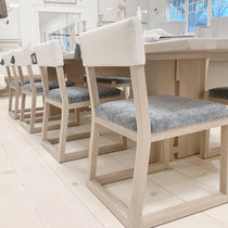 Shown in Lust Slate seat and Rome Ivory back. Oak finished in Nordic White / Natural