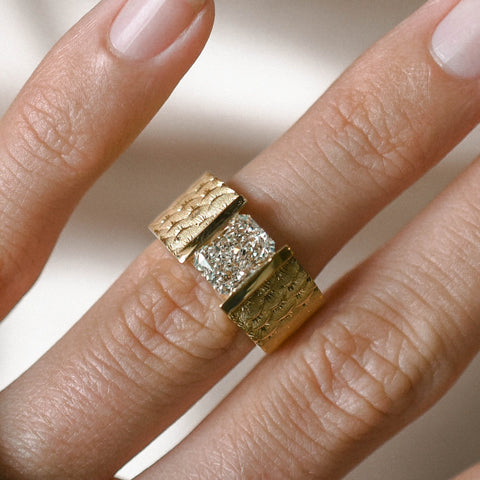 gold ring with channel set brilliant cut diamond set in shank with fish scales on the band