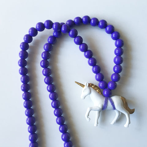 Pray4Trax Necklace White Unicorn On Purple