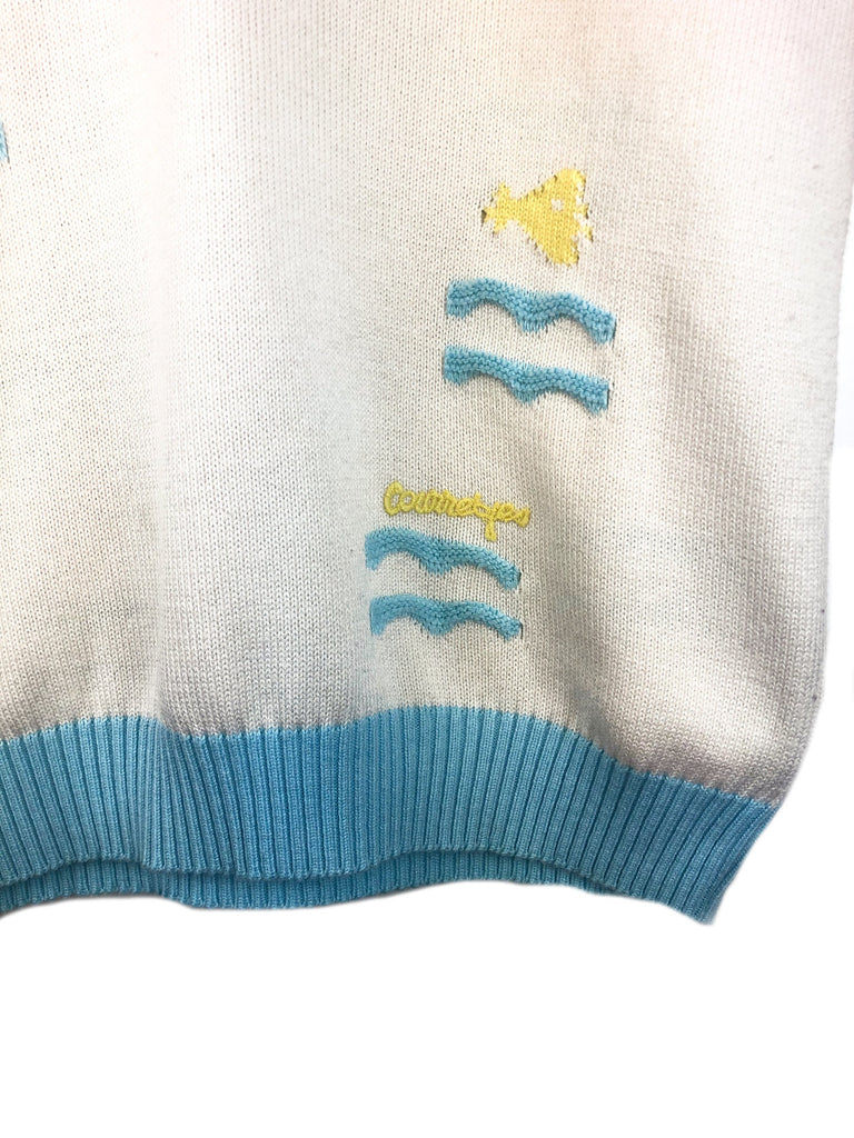 detail from courreges vintage pullover little yellow fish with yellow courreges logo plaisir palace best of vintage store paris chanel lanvin hermes ysl saint laurent mugler cardin balmain givenchy