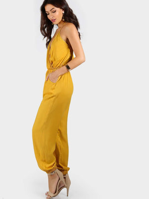Get Self Tie Halter Surplice Slanted Pocket Front Tapered Jumpsuit with RS. 1099.00