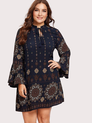 Get Trumpet Sleeve Frilled Tie Neck Ornate Dress with RS. 1224.00