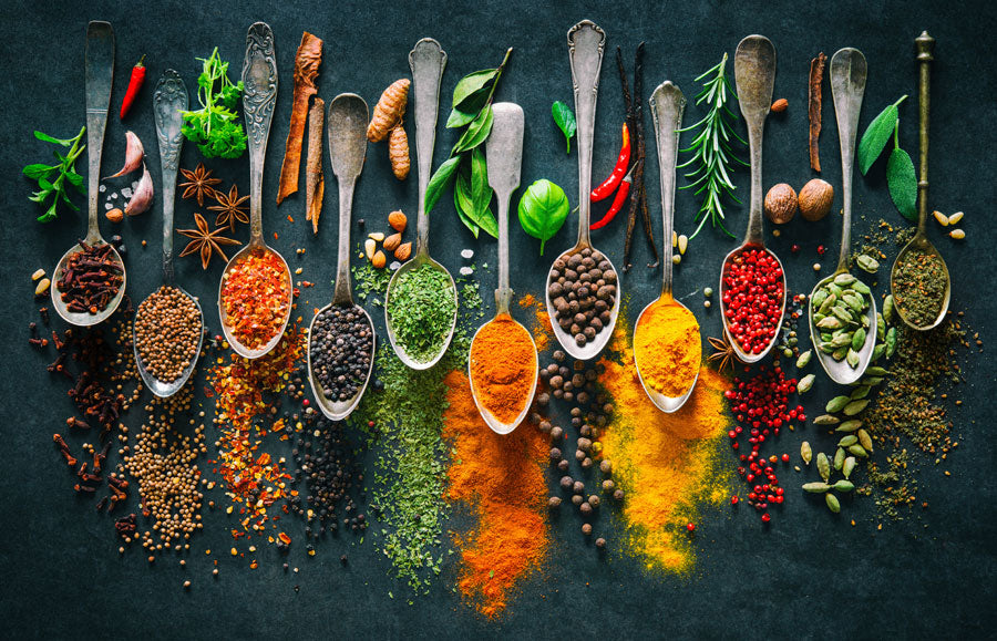 Spices spilling from spoons
