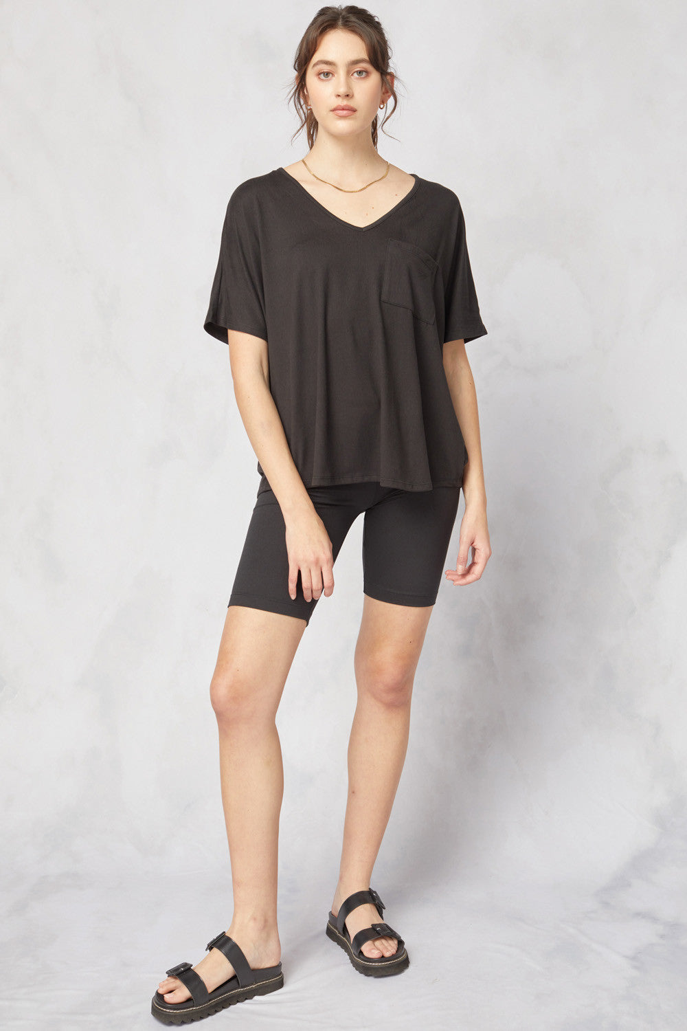 Solid v-neck short sleeve top featuring pocket at bust