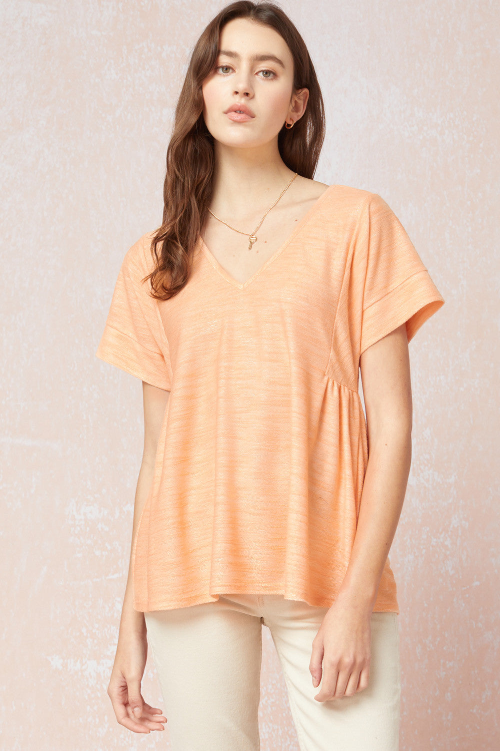 Heathered v-neck short sleeve top featuring gathered detail at sides