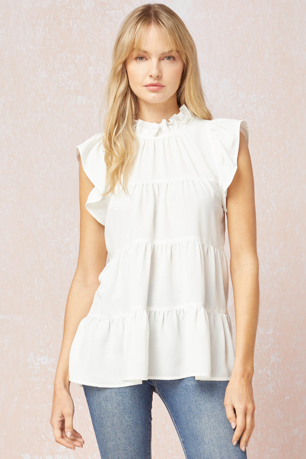 Solid mock neck ruffle sleeve tiered top featuring self tie detail at back.