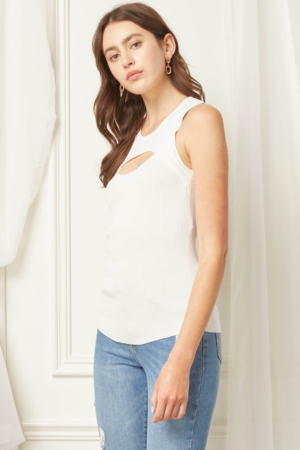 Solid ribbed round neck sleeveless top featuring cut out detail at bust