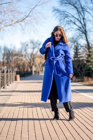 Model wearing the Blue Stella trench coat in the middle of the street