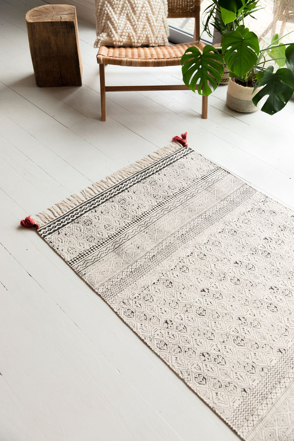 Black & White Hand Block Printed Cotton Rug With Red Tassels