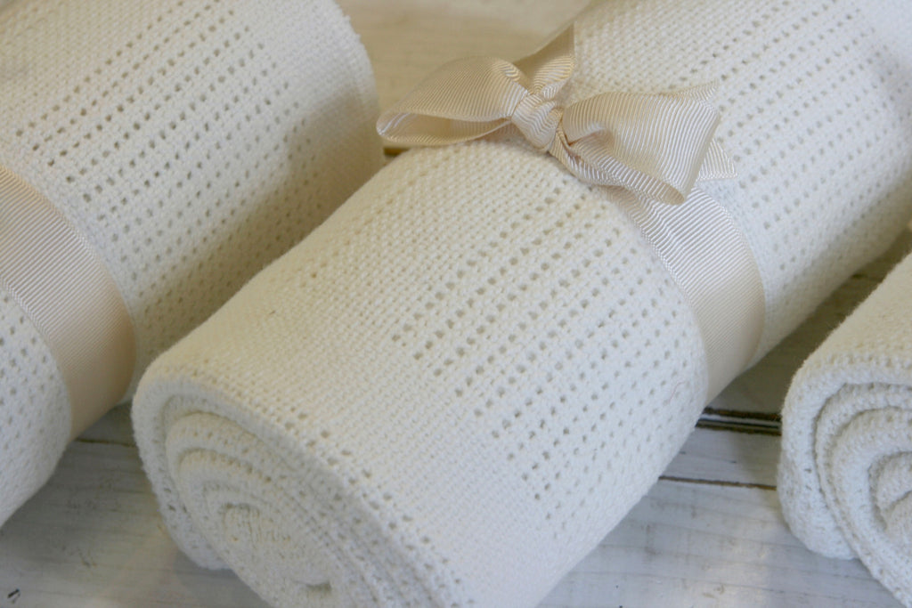 Antique white cotton cellular baby blanket, made in the UK