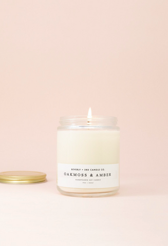 Oakmoss and Amber Soy Candle that comes with a cotton or wood wick.