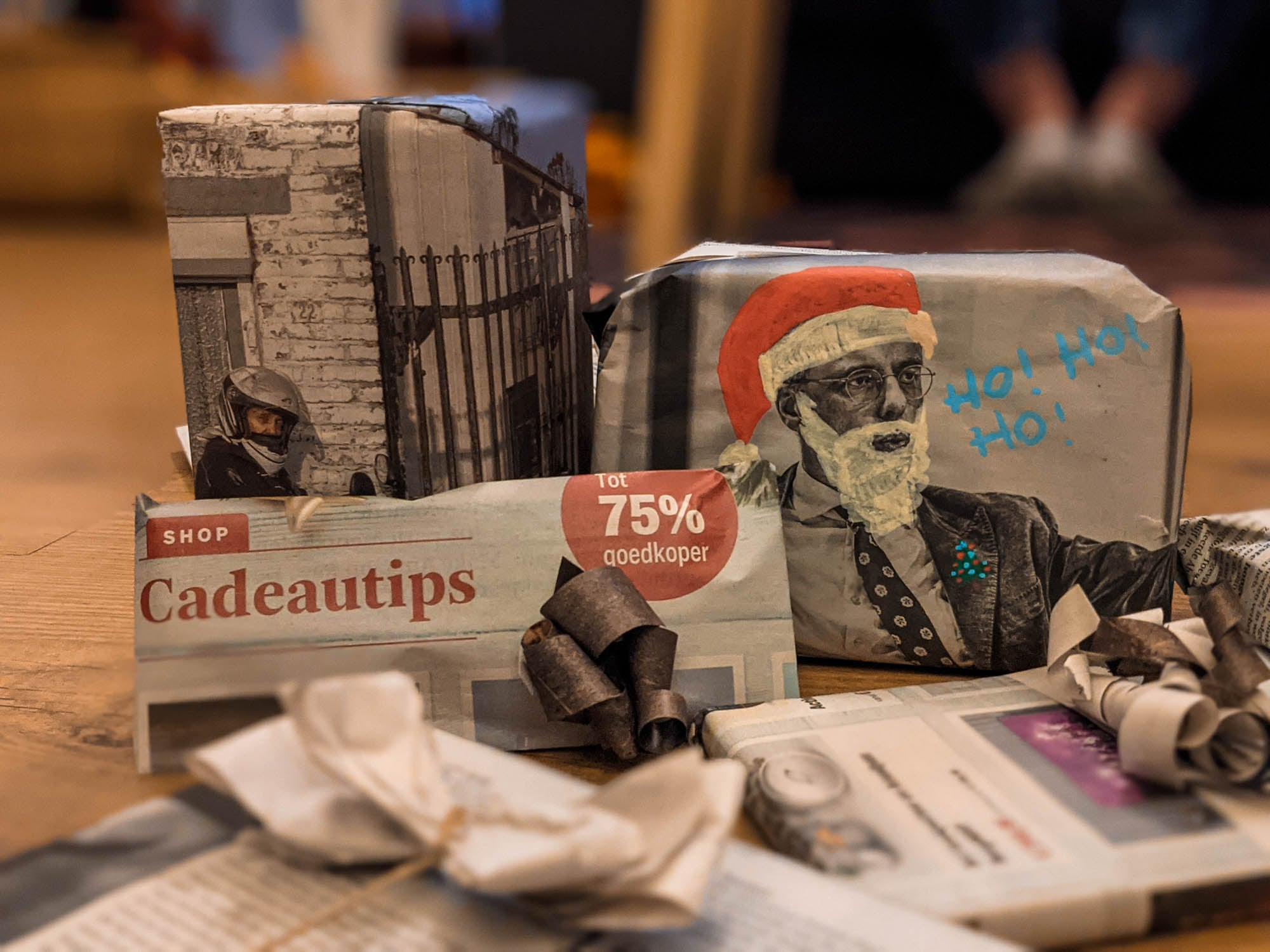 Christmas gifts wrapped and decorated with newspapers