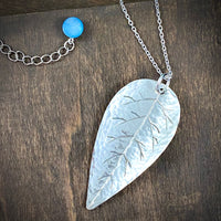Hand Crafted Silver Tone Leaf with Antique Blue Mother-of-Pearl Button Charm