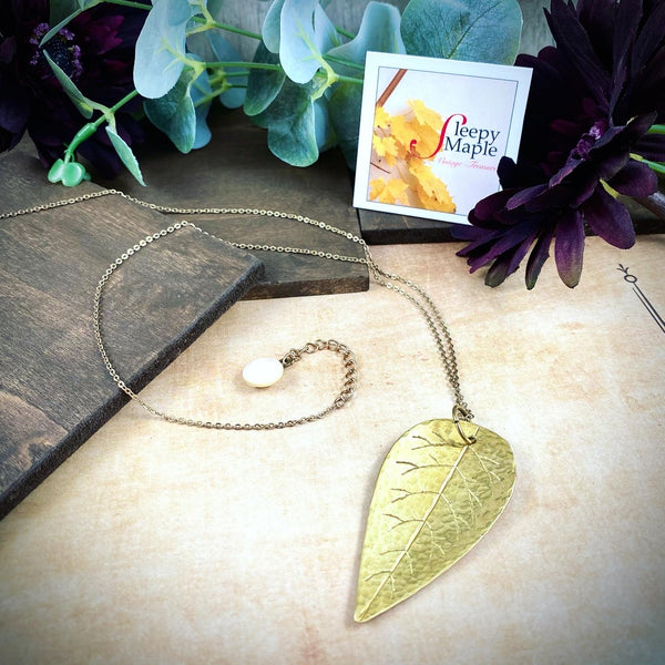 Hand Crafted Hammered Brass Leaf with Antique Mother-of-Pearl Button Charm