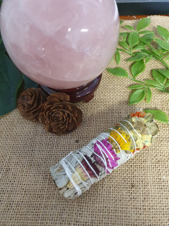 'Positive Intent' White Sage Smudge Stick with various dried flowers.