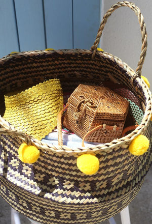 Wide Woven Straw Basket with Pom-poms