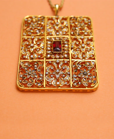 Handcrafted Box Pendant in Treated Rubies and Zircon