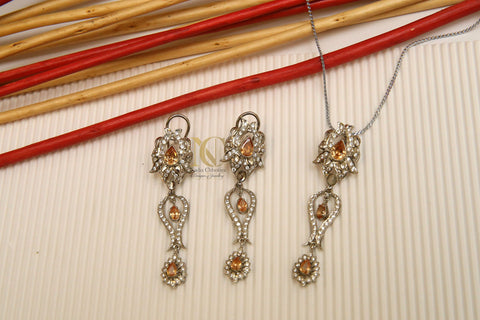 Champagne zircon and Kundan art work