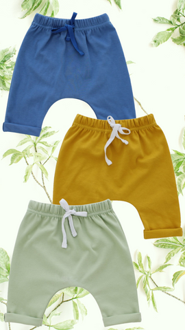 blue green yellow baby joggers with floral background
