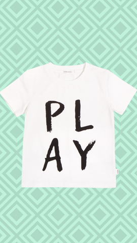 play all day shirt with green geometric background