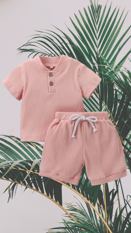 ribbed short and shirt set in pink with pink and green leaves background