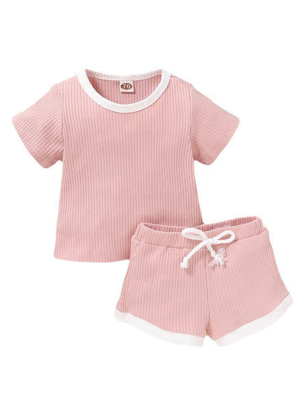 100% cotton pink ribbed shirt with white trim with 100% cotton pink ribbed shorts with white trim and faux drawstring.