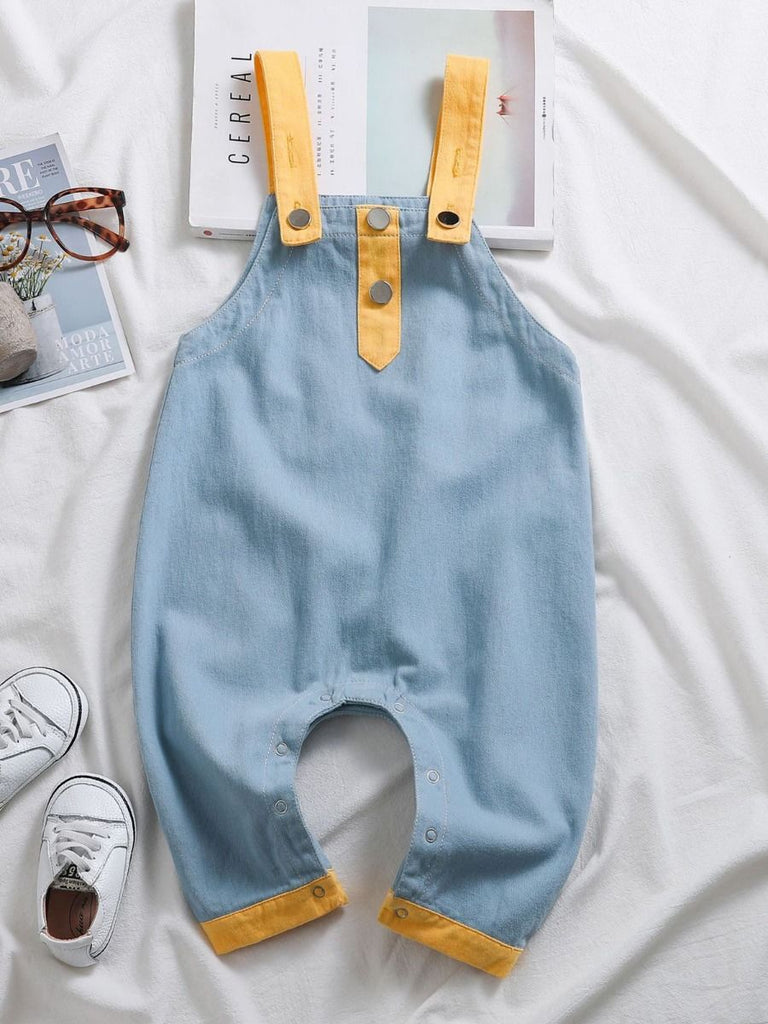 styled product shot blue and yellow baby overalls