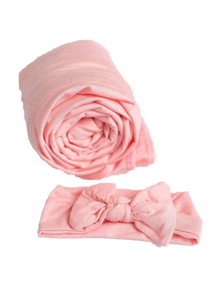 Pink swaddle and blanket set for baby girl