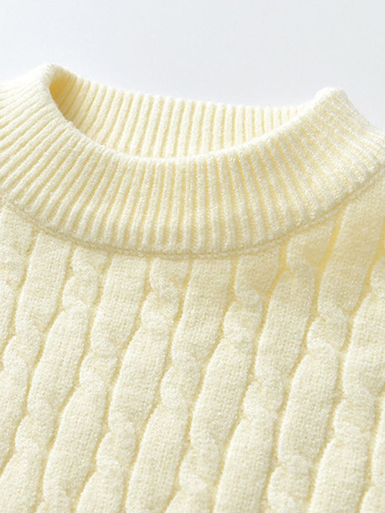 details of cable knit sweater in cream
