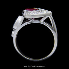 Bezel Set Oval Cut Ruby in Pear Shape Diamond Cluster w/ Pear Shape Sapphire and Round Brilliant Cut Side in 14k White Gold