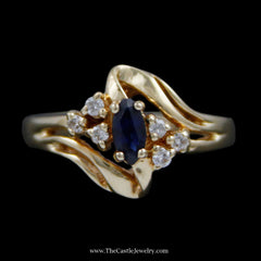 Marquise Sapphire Ring w/ Round Brilliant Cut Diamond Sides & Open Bypass Mounting in 14k YG