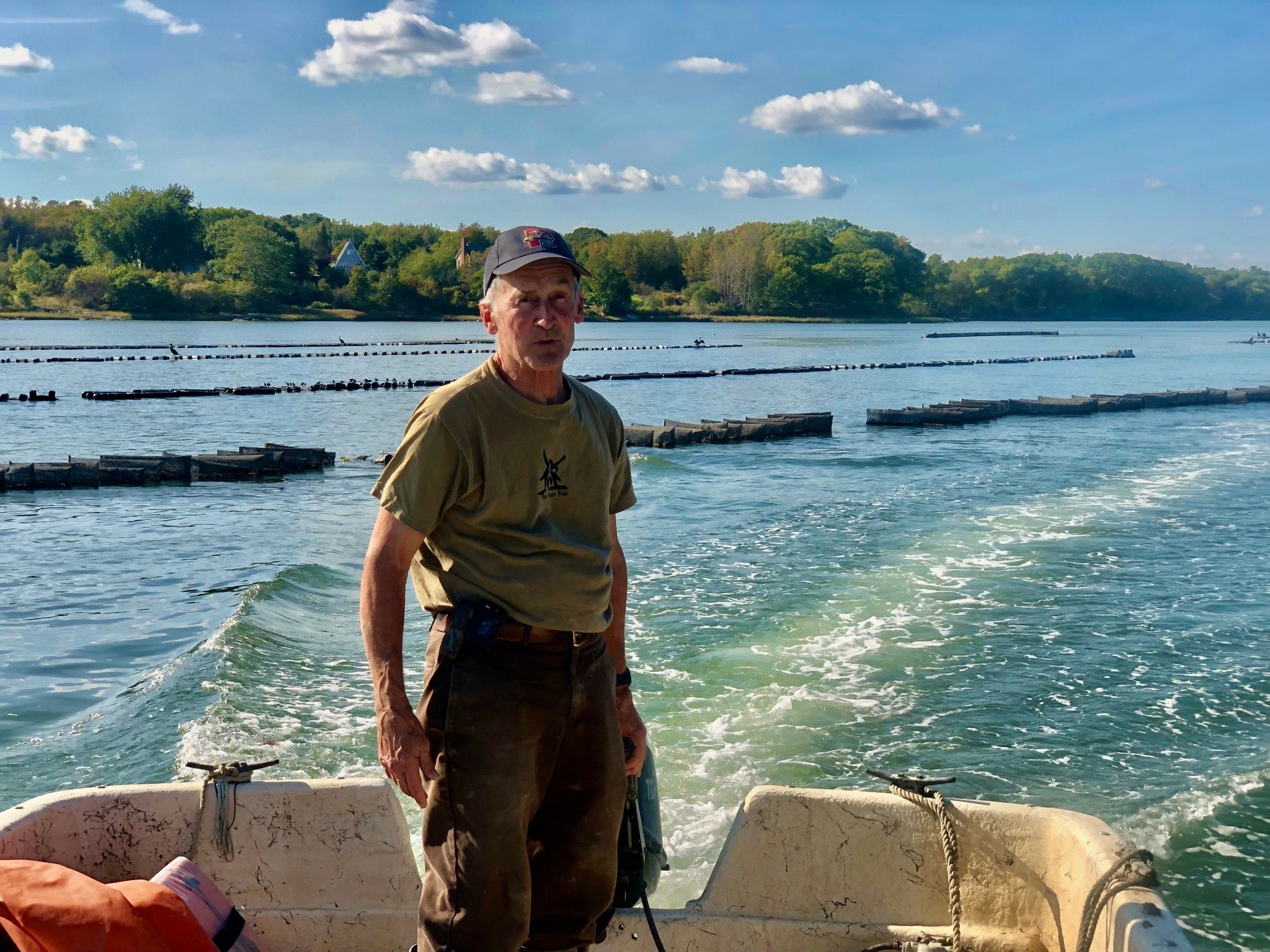 Oyster Farm manager, Ralph Hamill on the skiff.