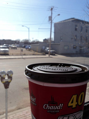 Coffee in cup sitting in a window