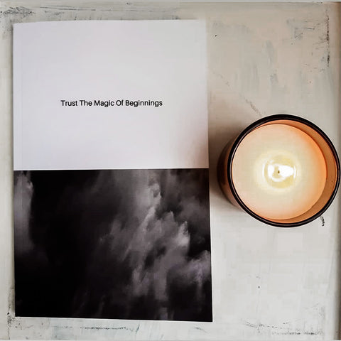 candle and notebook on white table