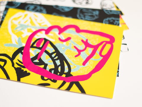 A group of five postcards with drawings of different colored fists on different colored backgrounds created by Loren Marple